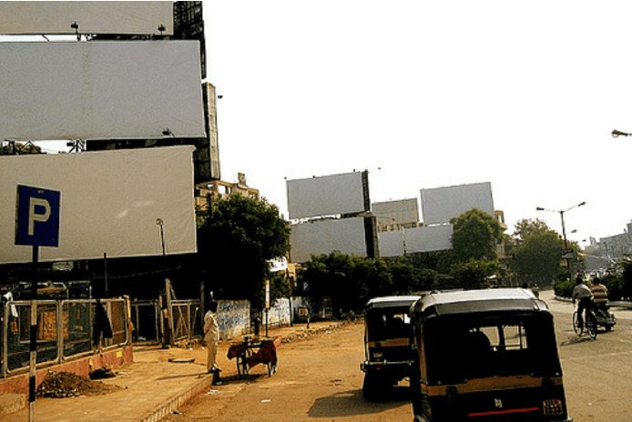 A photograph of empty advertising hoardings in Ahmedabad